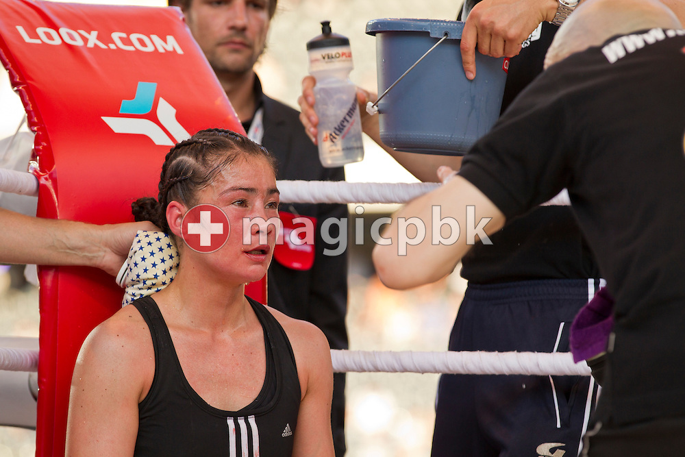 Aniya Seki of Switzerland is being treated during her fight against Eva Marcu of Hungary during their Super Flyweight title fight at the Stade de Suisse Wankdorf in Bern, Switzerland, Saturday, July 7, 2012. (Photo by Patrick B. Kraemer / MAGICPBK)