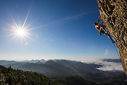 "Jim Thornburg climbing ""Smash and Grab"", an 5.11d sport climb at the Bear Cliff on Mt. St. Helena in Robert Louis Stevenson State Park near Calistoga, California."