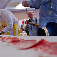Andras Godor lays his winning 234 cm long slice for judging during the first ever ham slicing competition in Budapest, Hungary on May 9, 2012. ATTILA VOLGYI