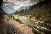 View looking out from the Peru Rail train travelling to machu Picchu. Looking down the Vilcanota River in the Sacred Valley of the Incas, Cusco region, Peru, South America