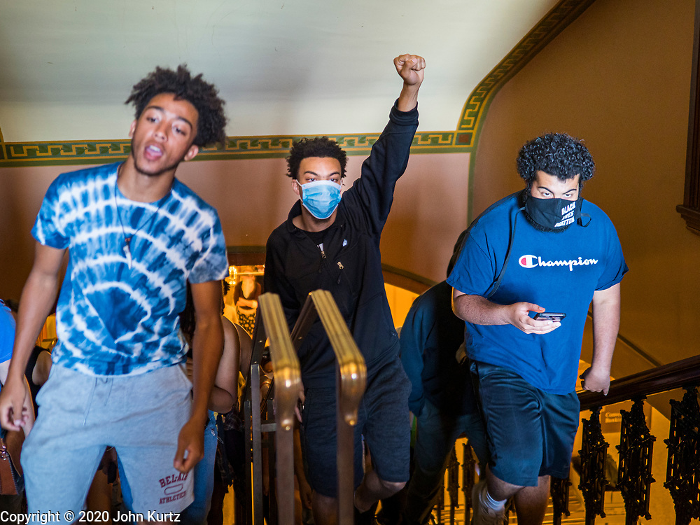 12 JUNE 2020 - DES MOINES, IOWA: CHARLES, (first name only) left, MATTHEW BRUCE, and JAYLEN CAVIL lead a group of Black Lives Matter protesters through the Iowa capitol. About 75 activists from Black Lives Matter came to the Iowa State Capitol in Des Moines Friday to talk to Iowa Governor Kim Reynolds. They've been trying to meet with Gov. Reynolds all week. She made time for them Friday and met with 5 representatives of the organization without any media in the room. They wanted to talk to her about police violence against African-Americans and racial disparities in Iowa's justice system. While the 5 met with the Governor, the remaining activists picketed the hall in front of her office and chanted.    PHOTO BY JACK KURTZ