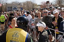 "Joan Samuelson walks toward start line with ""will power"" cap and borrowed sunglasses"