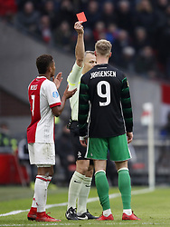 (L-R) David Neres of Ajax, referee Bjorn Kuipers, Nicolai Jorgensen of Feyenoord during the Dutch Eredivisie match between Ajax Amsterdam and Feyenoord Rotterdam at the Amsterdam Arena on January 21, 2018 in Amsterdam, The Netherlands