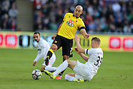 Nordin Amrabat of Watford breaks away from the tackle from Leon Britton of Swansea city (l) and Stephen Kingsley (r)..  Premier league match, Swansea city v Watford at the Liberty Stadium in Swansea, South Wales on Saturday 22nd October 2016.<br /> pic by  Andrew Orchard, Andrew Orchard sports photography.