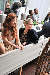 Left to right, OLIVIA GRANT and AMBER ATHERTON at a tea party organised by The Hub Magazine in aid of charity Kids Company held at The Sanderson, Berners Street, London on 2nd May 2012.