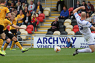 Joe Pigott of Newport county (l) shoots and scores his side's third goal. Skybet football league two match, Newport county v AFC Wimbledon at Rodney Parade in Newport, South Wales on Saturday 27th Sept 2014<br /> pic by Mark Hawkins, Andrew Orchard sports photography.