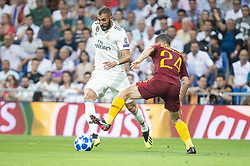 September 19, 2018 - Madrid, Spain - Real Madrid Karim Benzema and A.S.Roma Alessandro Florenzi during UEFA Champions League match between Real Madrid and A.S.Roma at Santiago Bernabeu Stadium in Madrid, Spain. September 19, 2018. (Credit Image: © Coolmedia/NurPhoto/ZUMA Press)