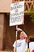 22 OCTOBER 2010 - PHOENIX, AZ:  A Tea Party supporter in Phoenix Friday. About 300 people attended a Tea Party rally on the lawn of the Arizona State Capitol in Phoenix Friday. They demanded lower taxes, less government spending, repeal of the health care reform bill, and strengthening of the US side of the US - Mexican border. They listened to Arizona politicians and applauded wildly when former Alaska Governor Sarah Palin and her son, Trig, made a surprise appearance. The event was a part of the Tea Party Express bus tour that is crossing the United States.     Photo by Jack Kurtz