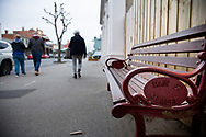 """A street bench is seen with """"Main Street Kilmore"""" written on its side as locals walk by during COVID-19 in Kilmore, Australia. An outbreak which started in Chadstone in Melbourne, has spread as far as Benalla. Twenty-eight people linked to the outbreak have now tested positive for COVID-19. There are now two confirmed cases in Kilmore linked with a Melbourne Resident who carried the virus into the town. The person visited the Odd Fellows Cafe in Kilmore which lead to him spreading the virus to a staff member, and a customer. The cafe has been closed for deep cleaning and will remain closed until the 19th October. (Photo by Dave Hewison/Speed Media)"""