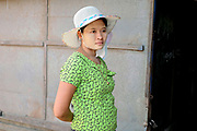 Portrait of a young woman wearing thanaka at Danyingone market on 16th May 2016 in Yangon, Myanmar. Thanaka is worn by many Burmese women as a traditional sunscreen and moisturiser