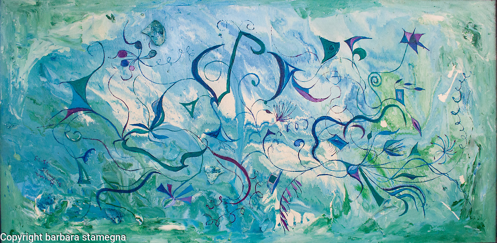 abstract art blue,green,purple shapes and lines on blue, white, green water like enamel background remembering orient impressions
