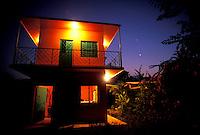 Custom home at twilight along the coast of Michoacan, Mexico.