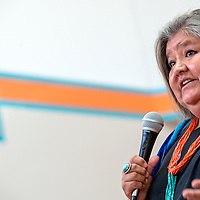 """071813       Cable Hoover<br /> <br /> Melanie Yazzie addresses a crowd during the opening of her exhibit """"Connecting Cultures: The Four Directions"""" at the Navajo Nation Museum in Window Rock Thursday."""