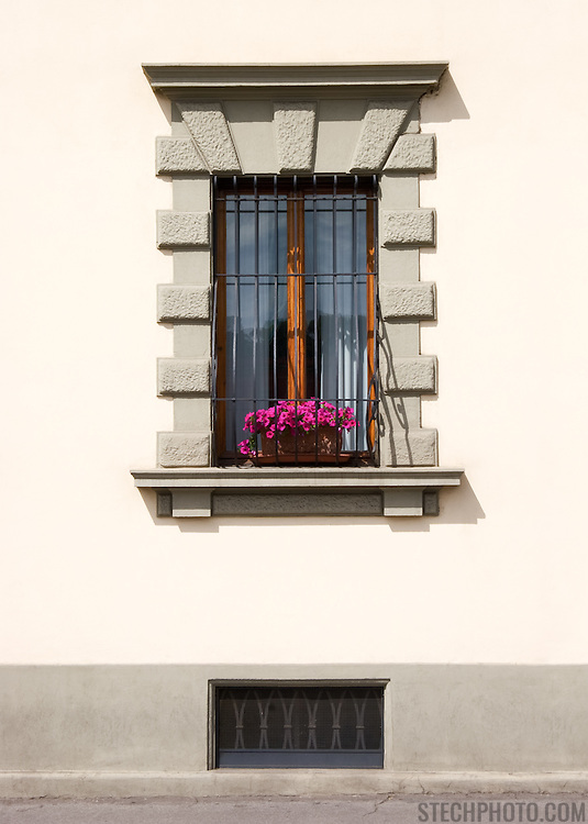An apartment window on a street in Florence, Italy.<br /> <br /> LICENSING: This is a Royalty Free (RF) image that can only be licensed through SpacesImages. Click on the link below:<br /> <br /> http://tinyurl.com/cw3mmuo