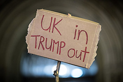 "© Licensed to London News Pictures . 20/02/2017 . Manchester , UK . Man with a home made "" UK in Trump out "" placard . Hundreds of protesters at a Stop Trump demonstration in Albert Square , central Manchester , to coincide with Parliament debating a petition calling for the government to cancel a State Visit by US President Donald Trump . Photo credit: Joel Goodman/LNP"