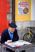 Spanish man reading newspaper at cafe in Santander, Cantabria, Northern Spain