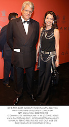 DR & MRS GERT RUDOLPH FLICK he is the German multi-millionaire at a party in London on 12th September 2002.PDE 210