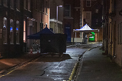 © Licensed to London News Pictures. 19/01/2021. Reading, UK. Police tents on Church Street in Reading at the scene where a man was stabbed. At approximately 20:15GMT on Monday 18/01/2021 in Church Street, Reading, a man in his forties was assaulted by a group of unknown offenders with weapons who fled the scene after the assault. The victim was taken to hospital with injuries consistent with having been stabbed. Photo credit: Peter Manning/LNP