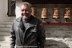 Kelly Modlin at the Buddhist monastery in Marpha on day-5  of our Himalayan Heroes adventure riding from Kalopani through the Mustang District to our highest elevation of the trip at over 12,000' when we reached Muktinath, Nepal. Saturday, November 10, 2018. Photography ©2018 Michael Lichter.