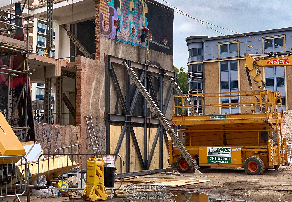 London, United Kingdom - 10 September 2019<br /> EXCLUSIVE SET - Aerial construction specialists and demolition experts use a huge crane to carefully lift intact, a twenty five ton, two-story wall, to preserve a famous Banksy rat image which has been covered up for years. Teams from specialist companies have spent over six weeks cutting around the artwork and fitting custom made eight ton steel supports to enable them to save the historic piece of art. Work has started on the construction of a new twenty seven floor art'otel hotel on the site of the old Foundry building in Shoreditch, east London, and a condition of the planning permission was to preserve the historical Banksy graffiti. A second section of the painting, an image of a TV being thrown through a broken window has already been cut out and moved separately. After the hotel construction is complete the two parts of the Banksy painting will be displayed on the hotel. Our pictures show the stages of work to protect the image, culminating in the lifting of the three story wall by crane. Video footage also available.<br /> (photo by: EQUINOXFEATURES.COM)<br /> Picture Data:<br /> Photographer: Equinox Features<br /> Copyright: ©2019 Equinox Licensing Ltd. +443700 780000<br /> Contact: Equinox Features<br /> Date Taken: 20190910<br /> Time Taken: 191431<br /> www.newspics.com