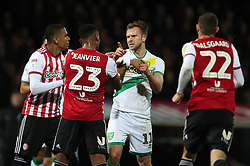Norwich City's Jordon Rhodes clashes with Brentford's Julian Jeanvier during the Sky Bet Championship match at Griffin Park, London.