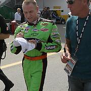 Sprint Cup Series driver Mark Martin (5) signs autographs at Daytona International Speedway on February 18, 2011 in Daytona Beach, Florida. (AP Photo/Alex Menendez)