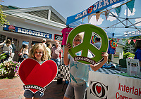 A little peace and love during the Ben & Jerry's grand opening celebration in Meredith's Mill Falls Marketplace.  (Karen Bobotas Photographer)