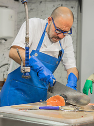 Man preparing fish with knife, Getxo, Algorta, Basque Country, Biscay, Spain, Europe