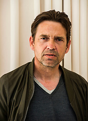 Pictured: Dougray Scott <br /> <br /> Dougray Scott was in Edinburgh to carry out his duties as a member of the Edinburgh International Film Festival jury and to promote his new film, The ReZort. He was joined by Director Steve Barker taking some time out before viewing another film as a Jury member.<br /> <br /> Film synopsis: Following a near apocalyptic zombie outbreak, humans now have the upper hand and life has returned to relative normality with only an occasional reminder or mention of recent horrific events. Most people wouldn't even blink at seeing a zombie now. They know how to handle them. It's no big deal because humans fought and won the battle and are in control again. The latest craze in this post zombie-outbreak world is the Zombie Safari: it is the newest and coolest thing in adventure holidays – a chance to go out and shoot the undead in the wild. The ultimate test in action and adventure, the ultimate blood sport and, to many, the ultimate in therapeutic revenge. But unbeknownst to most that go on Zafari, the park is a highly controlled and monitored environment; a maze of concealed security cameras, restraints and barriers. The eyes and ears of trained security personnel are on the guests - and the zombies 24/7, always ensuring a safe shooting distance between the living and the undead. Nothing is left to chance.Nothing is unplanned. So<br /> <br /> Ger Harley | EEm Date