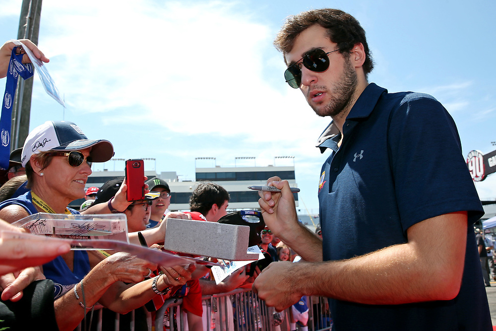 Apr 30, 2017; Richmond, VA, USA; NASCAR Cup Series driver Chase Elliott (24) signs autographs before the Toyota Owners 400 at Richmond International Raceway. Mandatory Credit: Peter Casey-USA TODAY Sports