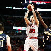 16 April 2011: Chicago Bulls shooting guard Kyle Korver (26) takes a jumpshot past Indiana Pacers point guard Darren Collison (2) during the Chicago Bulls 104-99 victory over the Indiana Pacers, during the game 1 of the Eastern Conference first round at the United Center, Chicago, Illinois, USA.