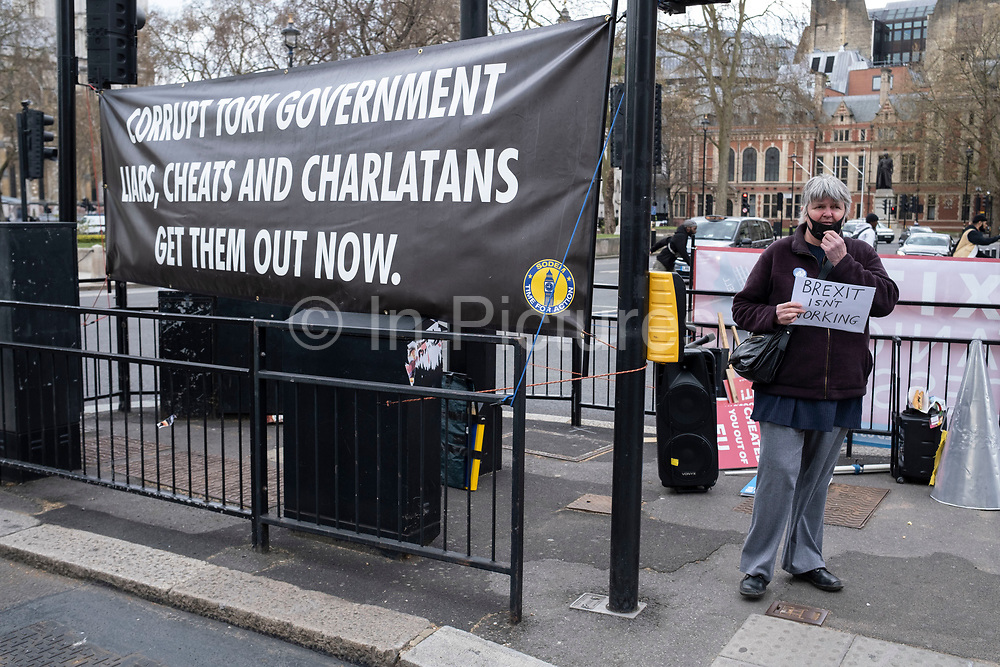 Anti corruption, anti Tory banner in Westminster on 14th April 2021 in London, United Kingdom. The banners have been put up outside Parliament by the anti-Brexit protesters and is against Conservative Party policy, and specifically now due to the Greensill lobbying scandal.
