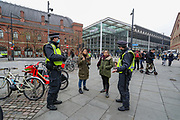 Police conducting a foot patrol around Kings Cross station are asking members of the Public to leave the area after an anti-lockdown protest was announced to oppose coronavirus restrictions in London, on Saturday, Nov 28, 2020. Some of the members of the public were challenged after seen not wearing face masks by the police, some of them were detained and arrested. (Photo/ Vudi Xhymshiti)