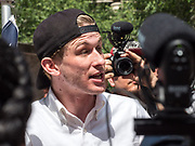 An anti-Sharia law protester talks to the media and other demonstrators at the demonstration in Chicago, Illinois
