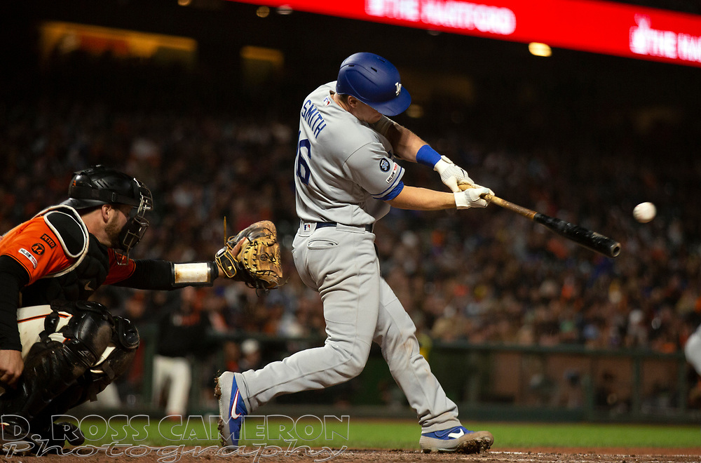 Sep 27, 2019; San Francisco, CA, USA; Los Angeles Dodgers Will Smith (16) connects with the bases loaded for a two-RBI single during the eighth inning of a baseball game against the San Francisco Giants at Oracle Park. Mandatory Credit: D. Ross Cameron-USA TODAY Sports