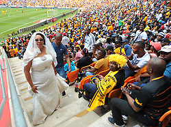 A woman in a wedding dress among hundreds of Kaiser Chiefs supporters who came in large numbers to support their team during the Soweto derby Kaizer  Chiefs and Orlando pirates for the PLS match at the FNB Stadium. Johannesburg.<br /> Picture: Itumeleng English/ African News Agency /ANA
