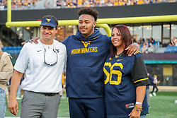 Sep 11, 2021; Morgantown, West Virginia, USA; Former West Virginia Mountaineers defensive lineman Darius Stills greets West Virginia Mountaineers head coach Neal Brown during 2020 senior recognition during halftime against the Long Island Sharks at Mountaineer Field at Milan Puskar Stadium. Mandatory Credit: Ben Queen-USA TODAY Sports