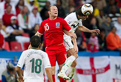 Wayne Rooney of England vs Marko Suler of Slovenia during the 2010 FIFA World Cup South Africa Group C Third Round match between Slovenia and England on June 23, 2010 at Nelson Mandela Bay Stadium, Port Elizabeth, South Africa. England defeated Slovenia 1-0 and qualified for the next round, Slovenia not. (Photo by Vid Ponikvar / Sportida)
