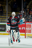 KELOWNA, CANADA - OCTOBER 13: Roman Basran #30 of the Kelowna Rockets skates to the bench with a hockey stick after breaking his goalie stick against the Tri-City Americans  on October 13, 2018 at Prospera Place in Kelowna, British Columbia, Canada.  (Photo by Marissa Baecker/Shoot the Breeze)  *** Local Caption ***