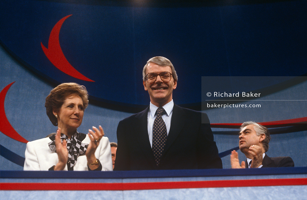 British Prime Minister, John Major acknowledges supporters during a Conservative party election rally on 14th March 1992, in Brighton, England. Major went on to win the election weeks later and was the fourth consecutive victory for the Conservative Party although it was its last outright win until 2015 after Labour's 1997 win for Tony Blair.