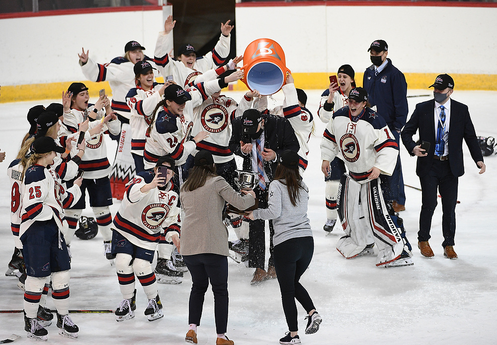 ERIE, PA - MARCH 06: Head Coach Paul Colontino of the Robert Morris Colonials gets a cooler of water dumped on him to celebrate after the Colonials defeated the Syracuse Orange 1-0 in the championship game at the Erie Insurance Arena on March 6, 2021 in Erie, Pennsylvania. (Photo by Justin Berl/Robert Morris Athletics)
