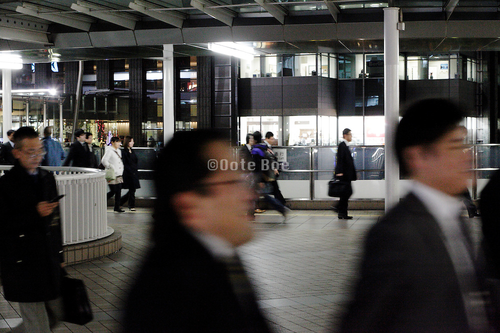 office people walking to and from Shinagawa station Tokyo