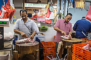 18 DECEMBER 2012 - SINGAPORE, SINGAPORE: Men cut up meat in a butcher stand in the wet market in Tekka Market in the Little India section of Singapore.  PHOTO BY JACK KURTZ