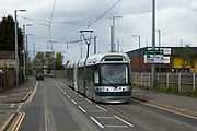 A Nottingham Express Transit NET tram heading towards Hucknall in Nottingham, Nottinghamshire, United Kingdom. The tram network in Nottingham has 51 stops and provides an alternative, more sustainable mode of transport for commuters and tourists.