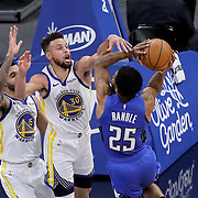 ORLANDO, FL - FEBRUARY 19:  Stephen Curry #30 of the Golden State Warriors fouls Chasson Randle #25 of the Orlando Magic during the second half at Amway Center on February 19, 2021 in Orlando, Florida. NOTE TO USER: User expressly acknowledges and agrees that, by downloading and or using this photograph, User is consenting to the terms and conditions of the Getty Images License Agreement. (Photo by Alex Menendez/Getty Images)*** Local Caption *** Stephen Curry; Chasson Randle