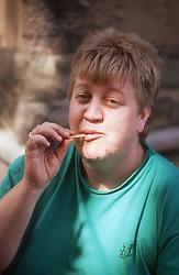 Portrait of woman eating crisps,
