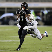 ORLANDO, FL - OCTOBER 03:  Jaylon Robinson #1 of the Central Florida Knights makes a catch in front of Akayleb Evans #26 of the Tulsa Golden Hurricane at Bright House Networks Stadium on October 3, 2020 in Orlando, Florida. (Photo by Alex Menendez/Getty Images) *** Local Caption *** Jaylon Robinson;  Akayleb Evans