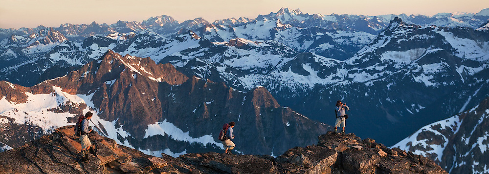 Kevin Steffa hikes out on a ridge to take pictures at sunset below Golden Horn, Okanogan National Forest, Washington. (digital composite)