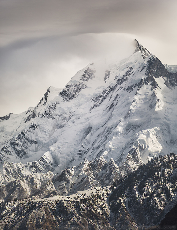 The summit of Mt Rakaposhi, 7,788 m (25,551 ft) towering above Hunza region.