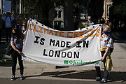 Young people stand alongside a Fossil Free London banner in Parliament Square during a Global Climate Strike to demand intersectional climate justice on 24th September 2021 in London, United Kingdom. The Global Climate Strike was organised to highlight the detrimental influences through colonialism, imperialism and exploitation of the Global North on MAPA Most Affected Peoples and Areas, which have contributed to them now experiencing the worst impacts of the climate crisis, and to call on the Global North to pay reparations to MAPA.